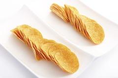 Potato chips on platter Royalty Free Stock Photography