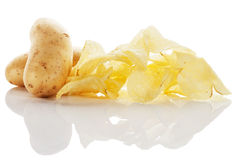 Potato chips with potatoes Royalty Free Stock Photo