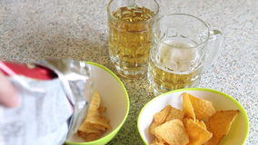 Potato chips poured into the cup stock footage