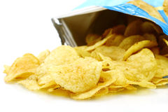 Potato chips poured out from packing Stock Photography
