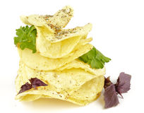 Potato Chips pyramid with basil and parsley. Isolated on white background Stock Images