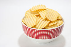 Potato chips in the red bowl Stock Image