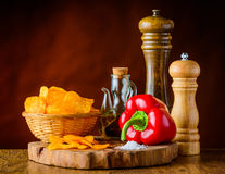 Potato Chips, Red Pepper and Ingredients Stock Photos
