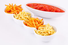 Potato chips and red sauce Royalty Free Stock Photography