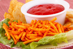 Potato chips and red sauce Stock Image