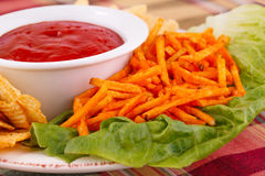 Potato chips and red sauce Royalty Free Stock Photos