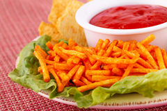 Potato chips and red sauce Royalty Free Stock Photo