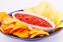 Potato chips and red sauce Royalty Free Stock Image