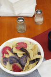 Potato Chips in Red White and Blue. Bowl of three different colors of chips, red yellow and purple, usually referred to as red, white and blue. Variety of potato stock photo