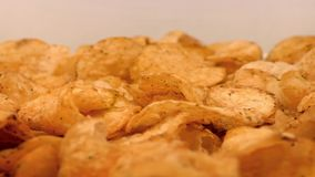 Potato Chips Rotating On Plate stock video footage