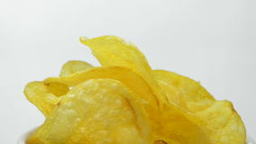 Potato chips rotating on white background stock video footage