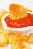 Potato chips and salsa dip Royalty Free Stock Photography