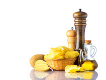 Potato Chips with Salt-mill and Pepper-mill Royalty Free Stock Photography