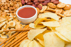Potato chips and salty snacks Stock Photos