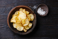 Potato chips and sea salt Royalty Free Stock Images