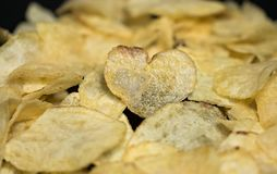 Potato chips in shape of heart close-up Royalty Free Stock Photo
