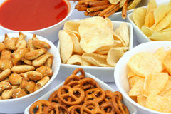 Potato chips and snacks Stock Photos