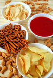 Potato chips, snacks and dip royalty free stock photography