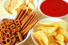 Potato chips, snacks and dip. Potato chips, other snacks and hot salsa dip sauce Stock Photos