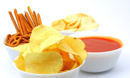 Potato chips, snacks and dip. Potato chips, other snacks and red hot salsa dip sauce Stock Photo