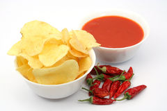 Potato chips, snacks and dip. Potato chips, other snacks and hot salsa dip sauce Royalty Free Stock Photos
