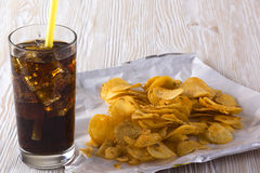 Potato chips with soda Royalty Free Stock Images