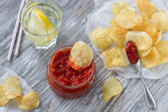 Potato chips with spicy tomato sauce Stock Photo