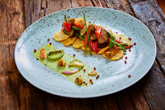 Potato Chips with sweet pepper, aubergine and asparagus. Stock Photo