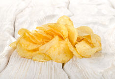 Potato chips on a table Royalty Free Stock Images