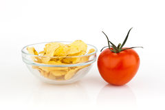 Potato chips with tomato. Royalty Free Stock Images