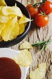 Potato chips, tomato and sauce Royalty Free Stock Photo