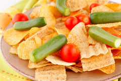 Potato chips and vegetables Royalty Free Stock Photos