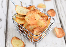 Potato chips. Or wafers fried or baked with pepper ,vinegar and salt.Served with ketchup or chutney as takeaway stock images