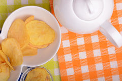 Potato chips on white bowl, close up Royalty Free Stock Photography