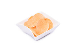 Potato chips on white bowl isolated Stock Photos
