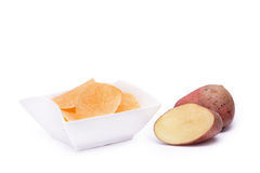 Potato chips on white bowl isolated Royalty Free Stock Images