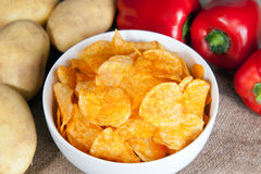 Potato chips in a white bowl Stock Image