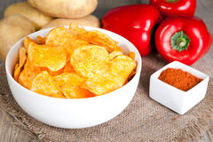 Potato chips in a white bowl Stock Images