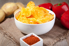 Potato chips in a white bowl Royalty Free Stock Image
