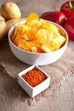 Potato chips in a white bowl Stock Photo