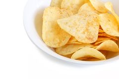 Potato Chips in a White China Bowl. A close up shot of some fresh potato chips in a white china bowl on white background royalty free stock photography