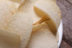 Potato chips on a white plate macro Stock Photography