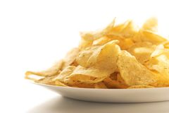Potato chips on a white plate stock photography