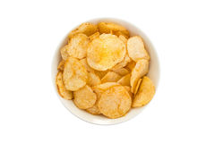 Potato chips in a white round bowl viewed from above. White round bowl full of potato chips viewed from above, isolated on white background Royalty Free Stock Photography