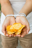 Potato chips in woman hand, tied with Measuring tape stock photos