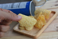 Potato chips in wood plate Stock Image