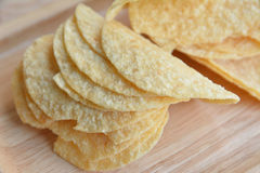 Potato chips in wood plate Royalty Free Stock Image