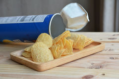 Potato chips in wood plate Royalty Free Stock Photo