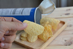 Potato chips in wood plate Stock Photos