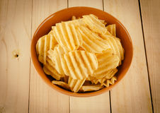 Potato chips on wood Stock Photo